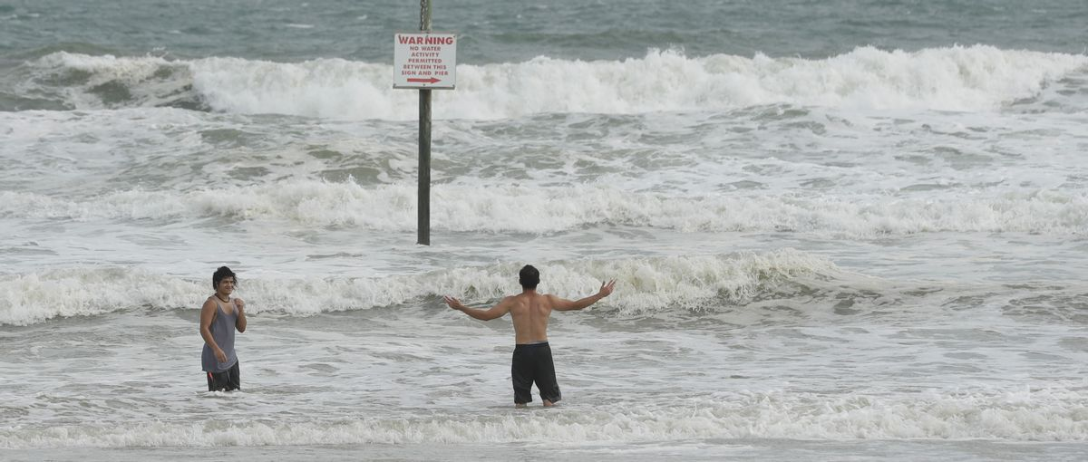 A pair of swimmers take advantage of the high surf from winds associated with Hurricane Matthew Thursday, Oct. 6, 2016, in Daytona Beach, Fla.  (AP)