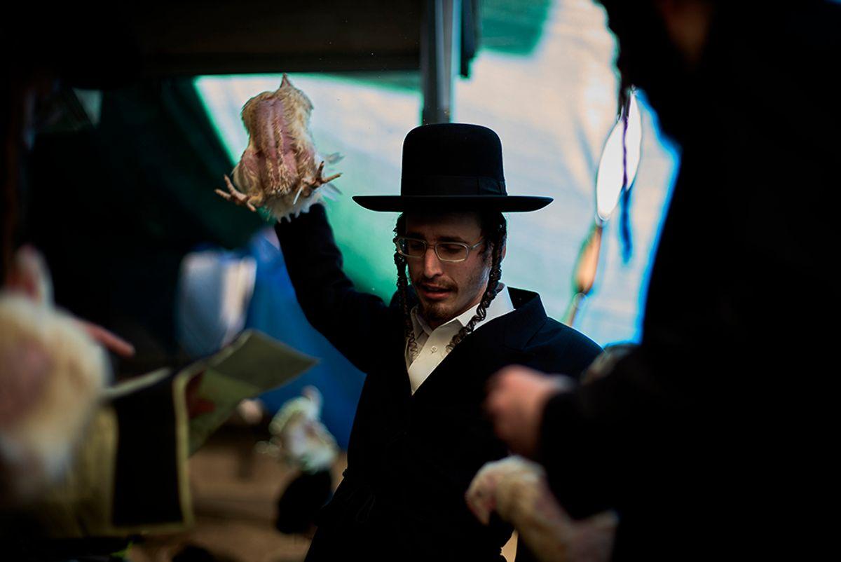 JERUSALEM, ISRAEL - OCTOBER 10:  An Ultra-Orthodox Jewish man performs the Kaparot ceremony on October 10, 2016 in Jerusalem, Israel.  (Getty Images)