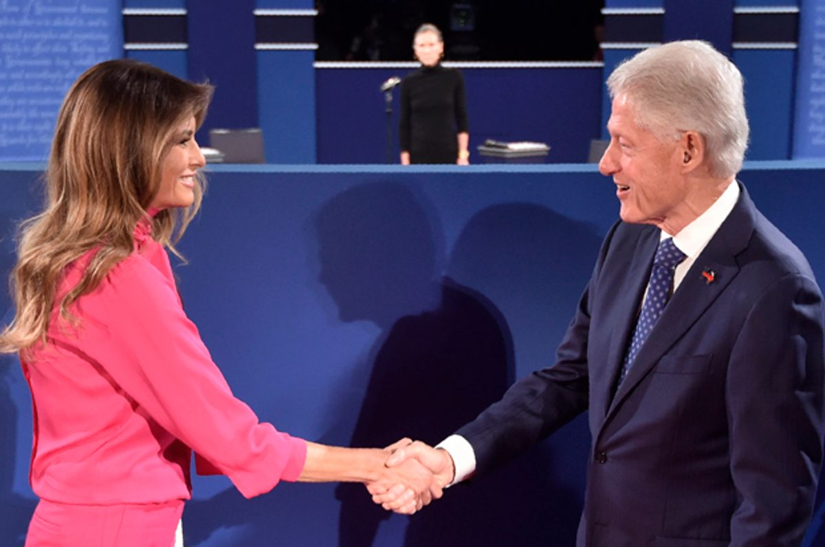 Bill Clinton greets Melania Trump before the start of the second presidential debate in St. Louis, Missouri on October 9, 2016.   (Getty/Paul J. Richards)