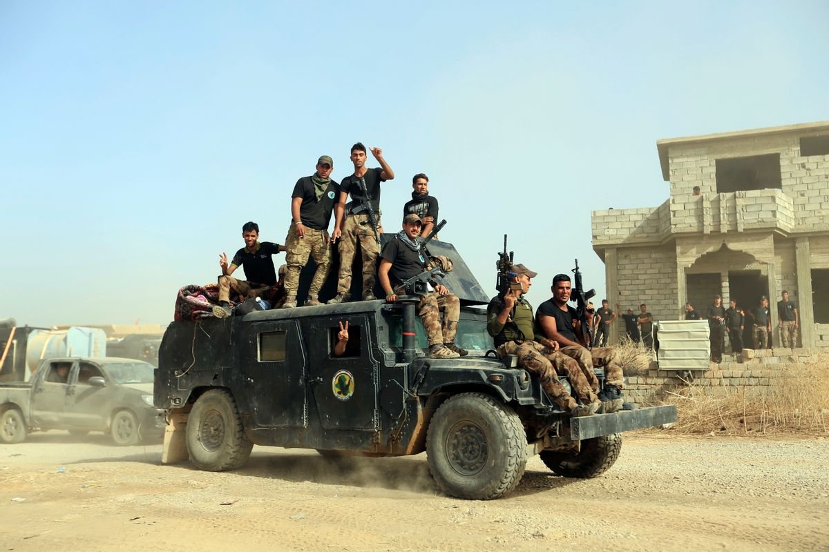 FILE -- In this Saturday, Oct. 15, 2016, file photo, Iraq's elite counterterrorism forces gather ahead of an operation to re-take the Islamic State-held City of Mosul, outside Irbil, Iraq. Iraqi forces appear poised to launch their most complex anti-IS operation to date: retaking the country's second largest city of Mosul. While the country's military has won a string of territorial victories that have pushed IS out of more than half of the territory the group once held, some Iraqi officials worry that the Mosul fight has been rushed and if the city is retaken without a plan to broker a peace, it could lead to more violence.  (AP Photo/Khalid Mohammed, File) (AP)