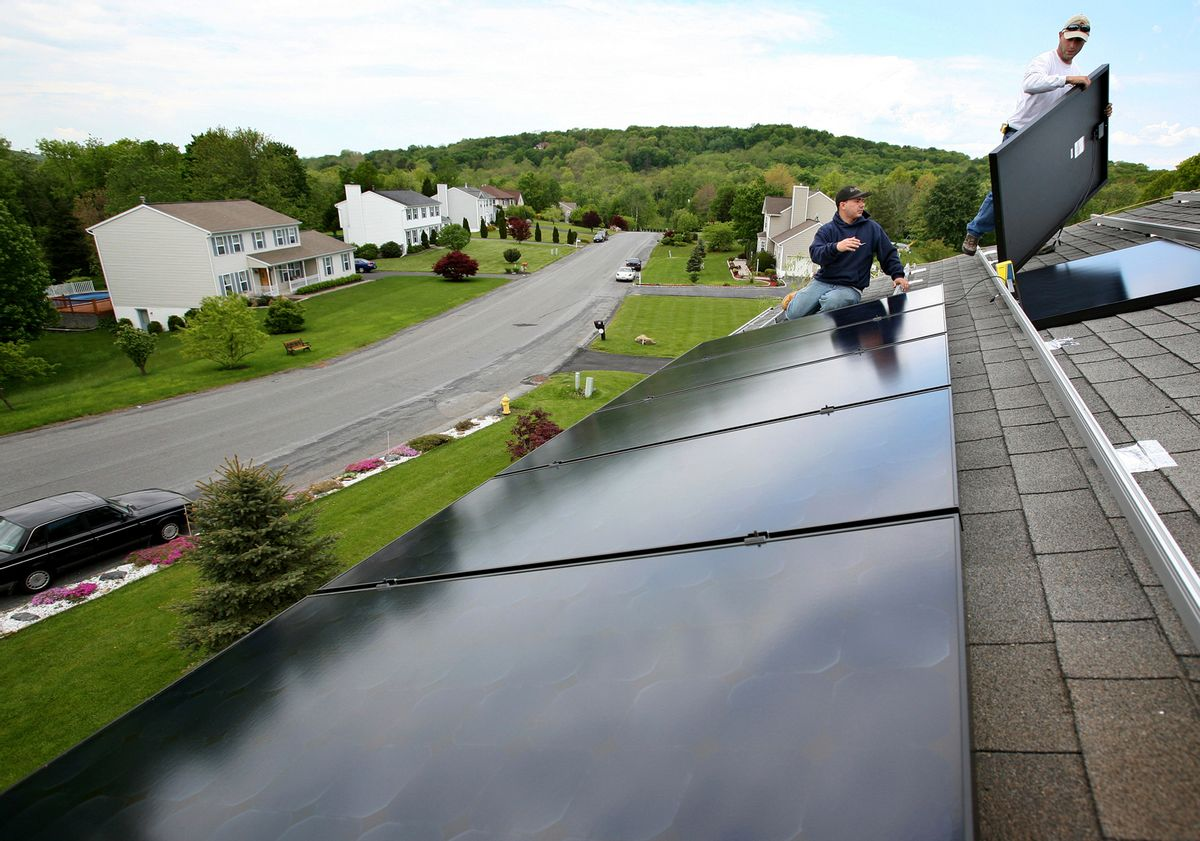 FILE - In this May 21, 2008, file photo, Marco DelTreste, left, and Arsenio Patricio, of Mercury Solar Systems, install panels on the roof of a home in Newburgh, N.Y. Energy-efficient upgrades can not only shrink your utility bill; they can increase the value of your home. The payoff time and the savings from installing solar panels will vary depending on where you live. (AP Photo/Craig Ruttle, File) (AP)