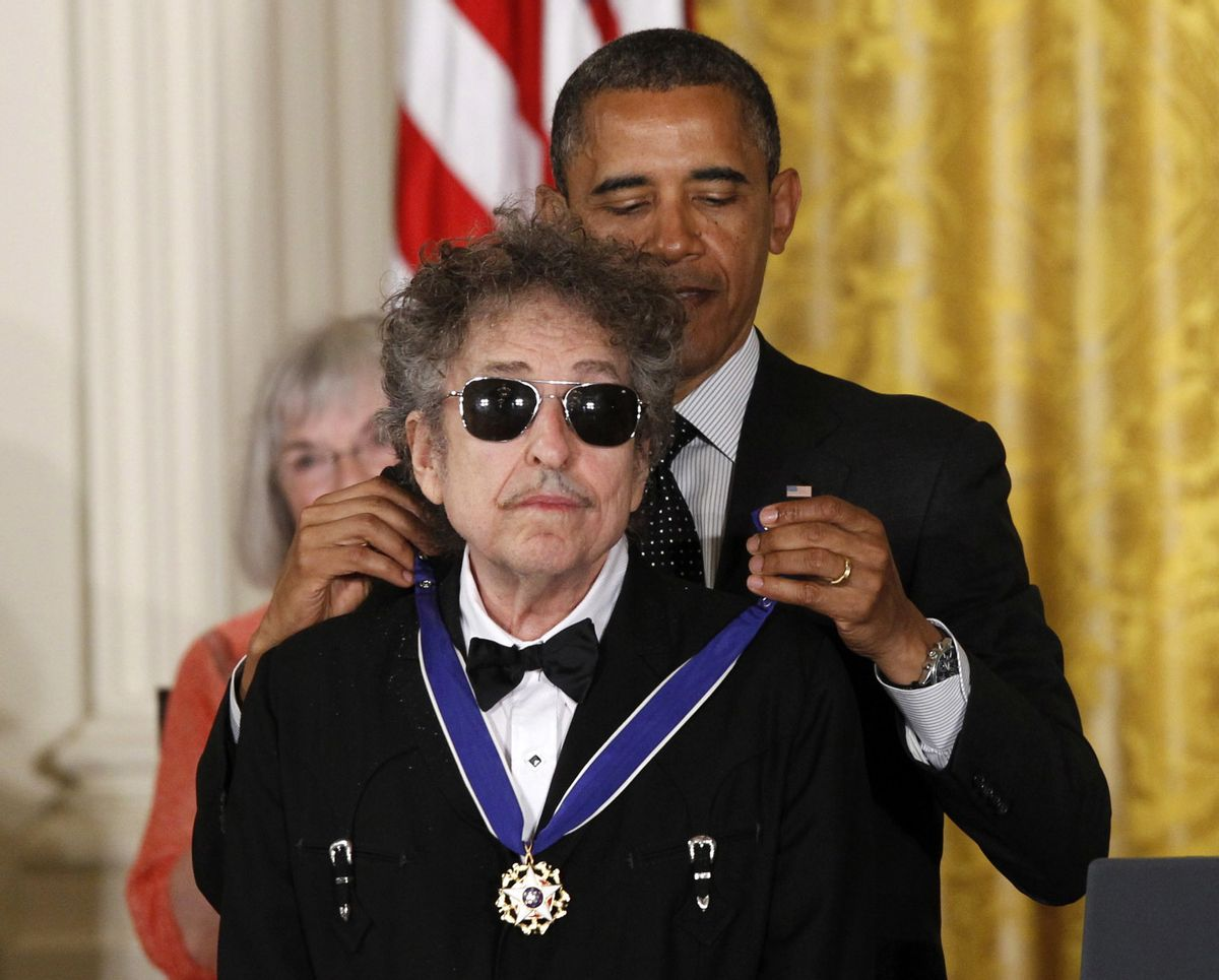 FILE - In this May 29, 2012, file photo, President Barack Obama presents rock legend Bob Dylan with a Medal of Freedom during a ceremony at the White House in Washington. Dylan won the 2016 Nobel Prize in literature, announced Thursday, Oct. 13, 2016.  (AP)