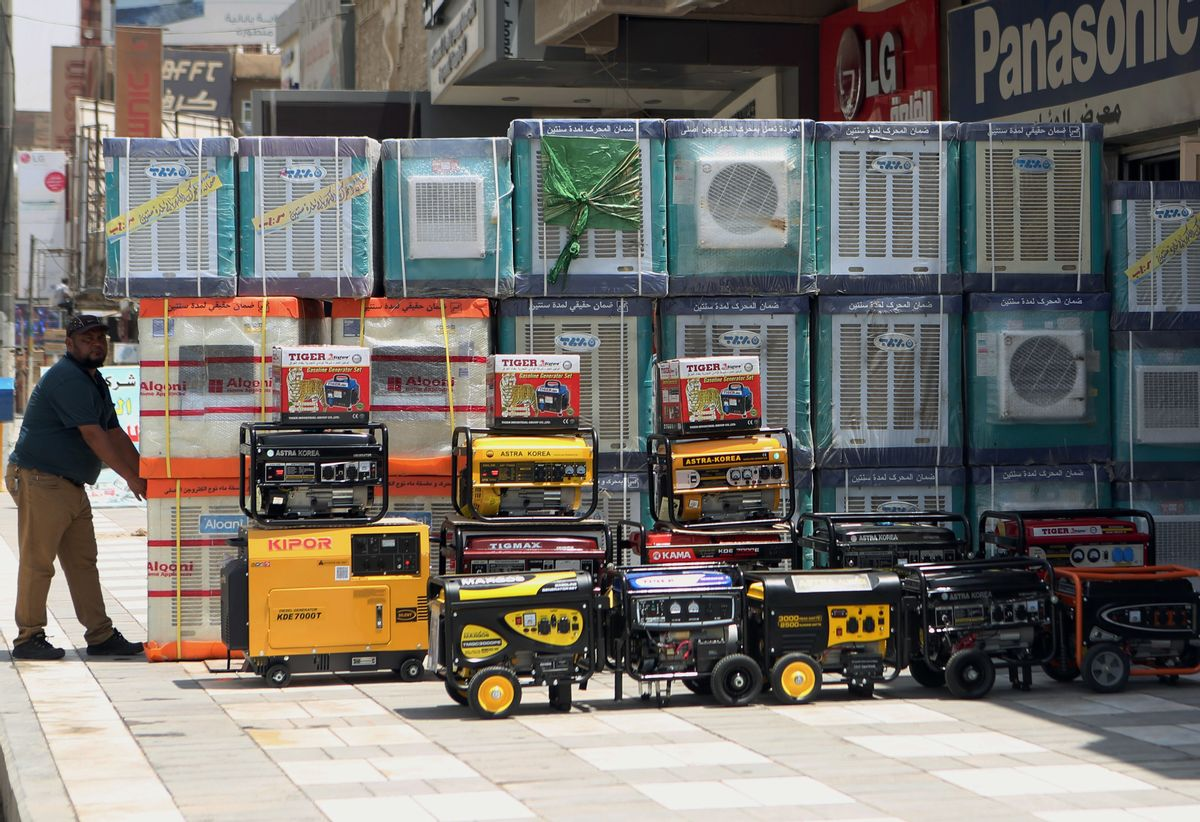FILE - In this Thursday, July 30, 2015 file photo, air conditioners and power generators are displayed on a street in central Baghdad, Iraq. Nations reached a deal Saturday, Oct. 15, 2016 to limit the use of hydrofluorocarbons, or HFCs - greenhouse gases far more powerful than carbon dioxide that are used in air conditioners and refrigerators, in a major effort to fight climate change. (AP Photo/ Khalid Mohammed, File) (AP)