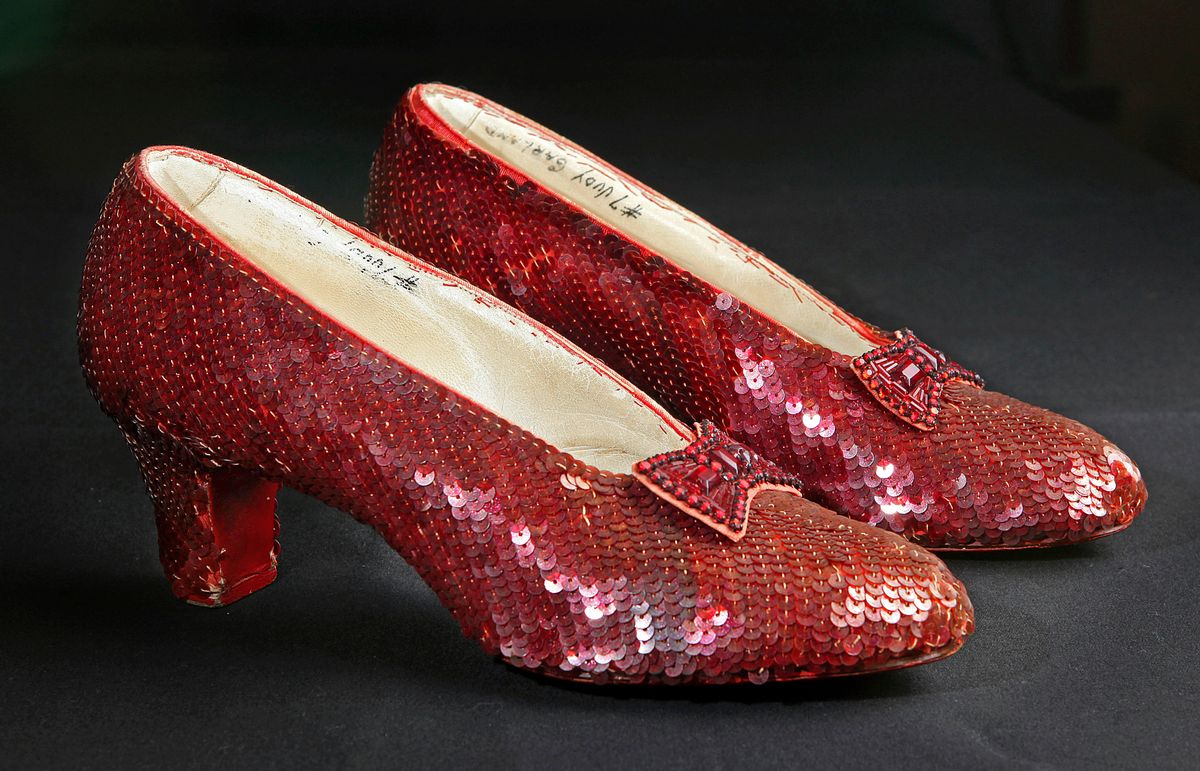 """File- This Nov. 9, 2001, file photo shows the sequin-covered ruby slippers worn by Judy Garland in """"The Wizard of Oz""""  at the offices of Profiles in History in Calabasas, Calif. Smithsonian Museum officials started a Kickstarter fundraising drive Monday, Oct. 17, 2016,  to repair the iconic slippers from 1939's """"The Wizard of Oz"""" and create a new state-of-the-art display case for them at the National Museum of American History.  (AP Photo/Reed Saxon, File) (AP)"""