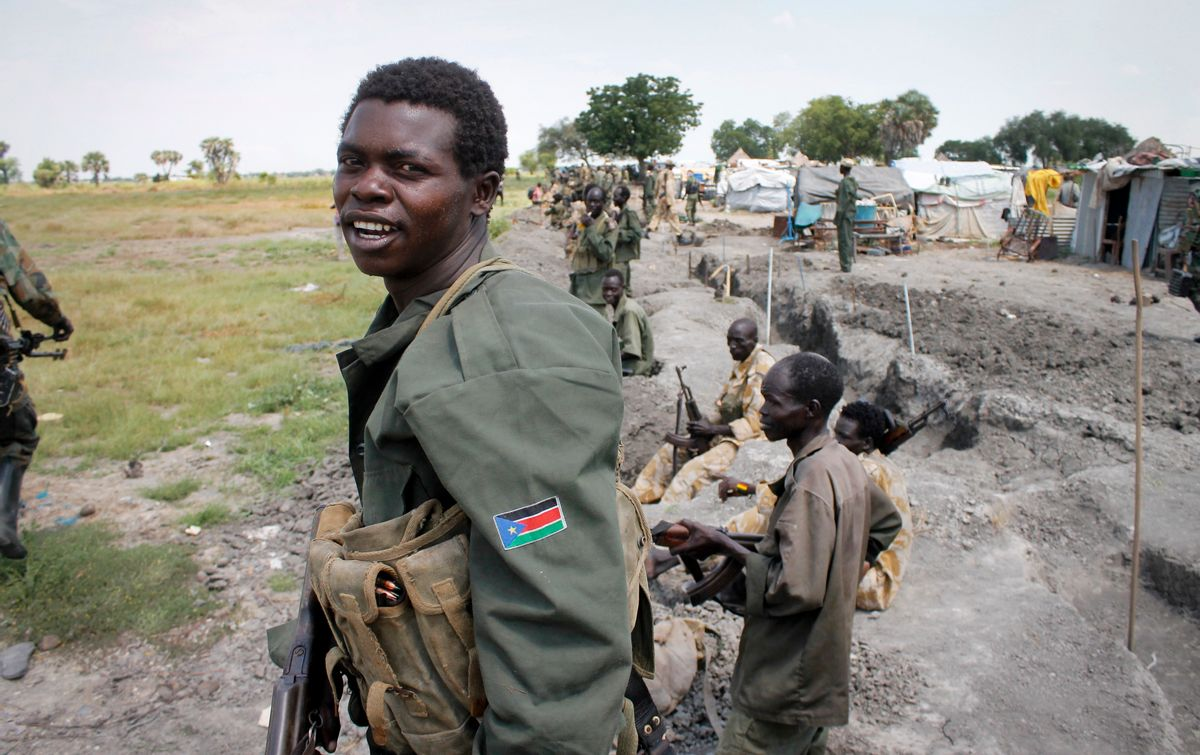 In this photo taken Sunday, Oct. 16, 2016, South Sudanese government soldiers stand in trenches in Malakal, South Sudan. Following clashes last week in the outskirts of the city, which has been reduced to rubble and almost entirely deserted by civilians, the army flew in journalists on Sunday to show that they retain control of the strategic city, even though rebels still vow to take it. (AP Photo/Justin Lynch) (AP)