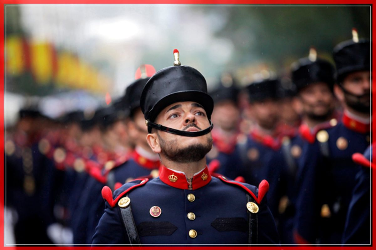 """A Spanish soldier looks up as he marches with others in a military parade during a national holiday known as """"Dia de la Hispanidad"""" or Hispanic Day, in Madrid, Spain, Wednesday, Oct. 12, 2016. Almost a year into Spain's political deadlock, the country is celebrating its National Day with a military parade of over 3,000 soldiers marching through Madrid and aircraft drawing trails of red and yellow smoke in the sky to represent the flag. (AP Photo/Francisco Seco) (AP)"""