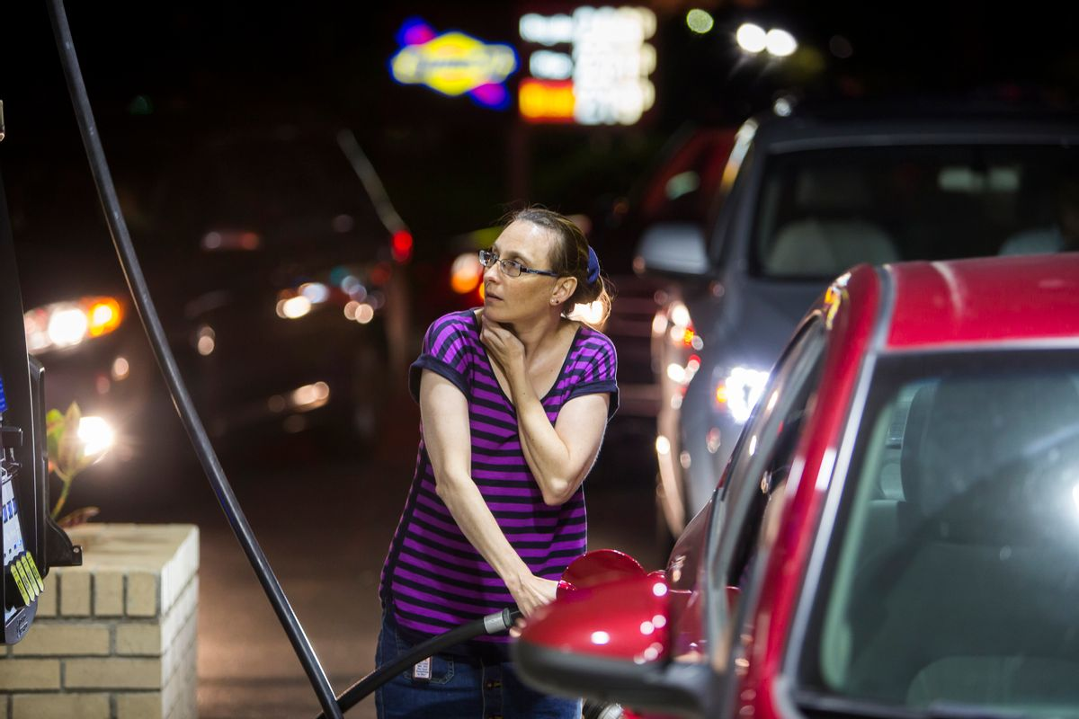 Beth Johnson fills up her car after waiting in line at a Sunoco gas station  in advance of Hurricane Matthew in Mt. Pleasant, S.C., Tuesday, Oct. 4, 2016. Hurricane Matthew is expected to affect the South Carolina coast by the weekend. Gov. Nikki Haley announced Tuesday that, unless the track of the storm changes, the state will issue an evacuation order Wednesday to help get 1 million people inland from the coast.  (AP Photo/Mic Smith) (AP)