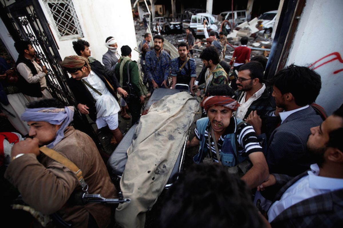 Yemenis carry the body of a man killed in a Saudi-led coalition airstrike on mourners at a funeral hall in Sana'a, Yemen on Saturday, October 8, 2016  (Reuters/Khaled Abdullah)