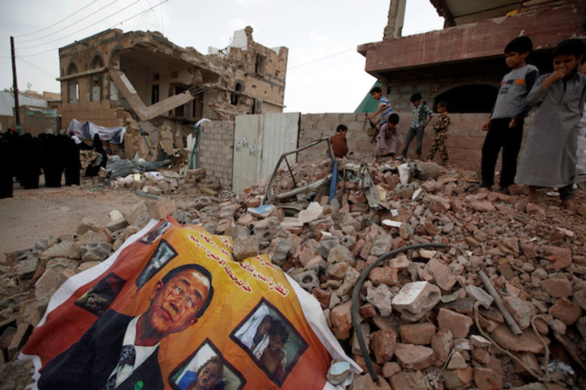 A defaced poster of the U.N. Secretary-General Ban Ki-moon on the rubble of a house during a vigil marking one year since a Saudi-led airstrike on a residential area in Yemens capital Sana'a, June 21, 2016  (Reuters/Khaled Abdullah)