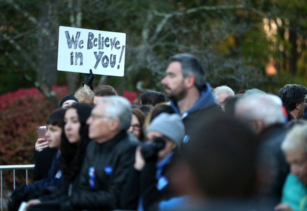 Supporters wait to greet Democratic presidential candidate Hillary Clinton at her polling place in Chappaqua, N.Y., Tuesday, Nov. 8, 2016. (AP Photo/Seth Wenig) (AP)