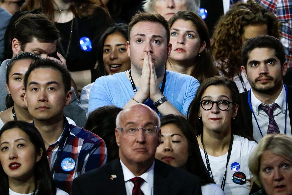 Guests at Democratic presidential nominee Hillary Clinton's election night rally watch the big screen television at the Jacob Javits Center glass enclosed lobby in New York. (AP)