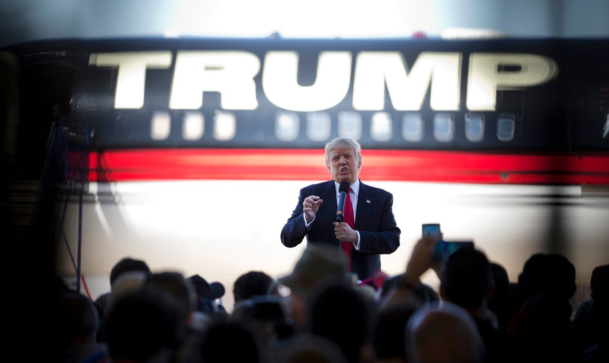 FILE - In this Saturday, Feb. 27, 2016 file photo, Republican presidential candidate Donald Trump stands in front of his airplane as he speaks during a rally in Bentonville, Ark. (AP Photo/John Bazemore) (AP)