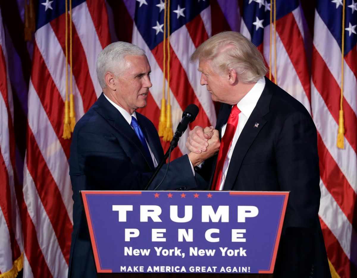 President-elect Donald Trump shakes hands with Vice President-elect Mike Pence as he gives his acceptance speech during his election night rally, Wednesday, Nov. 9, 2016, in New York. (AP Photo/John Locher) (AP)