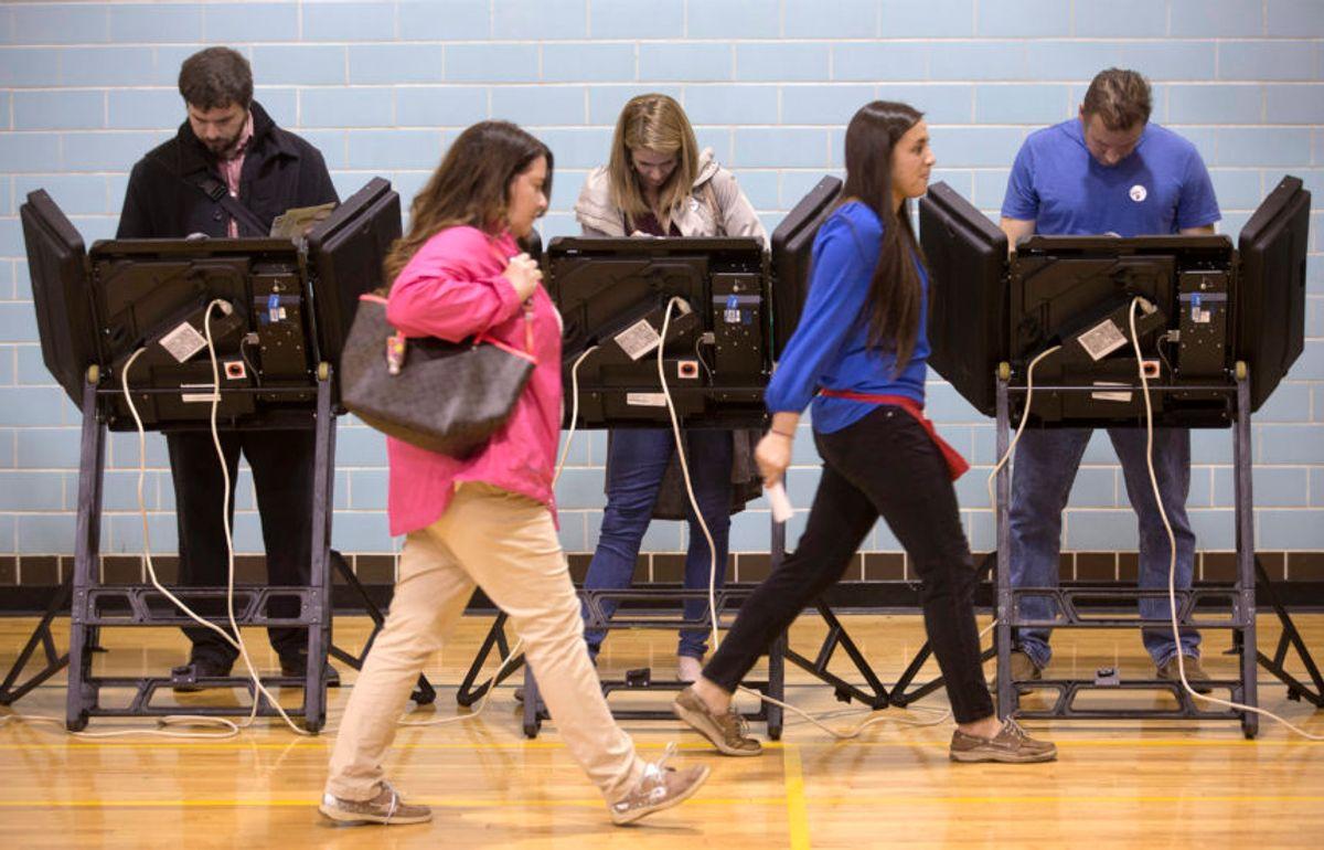 Voters in Ohio, 2015. (AP Photo/John Minchillo, File)