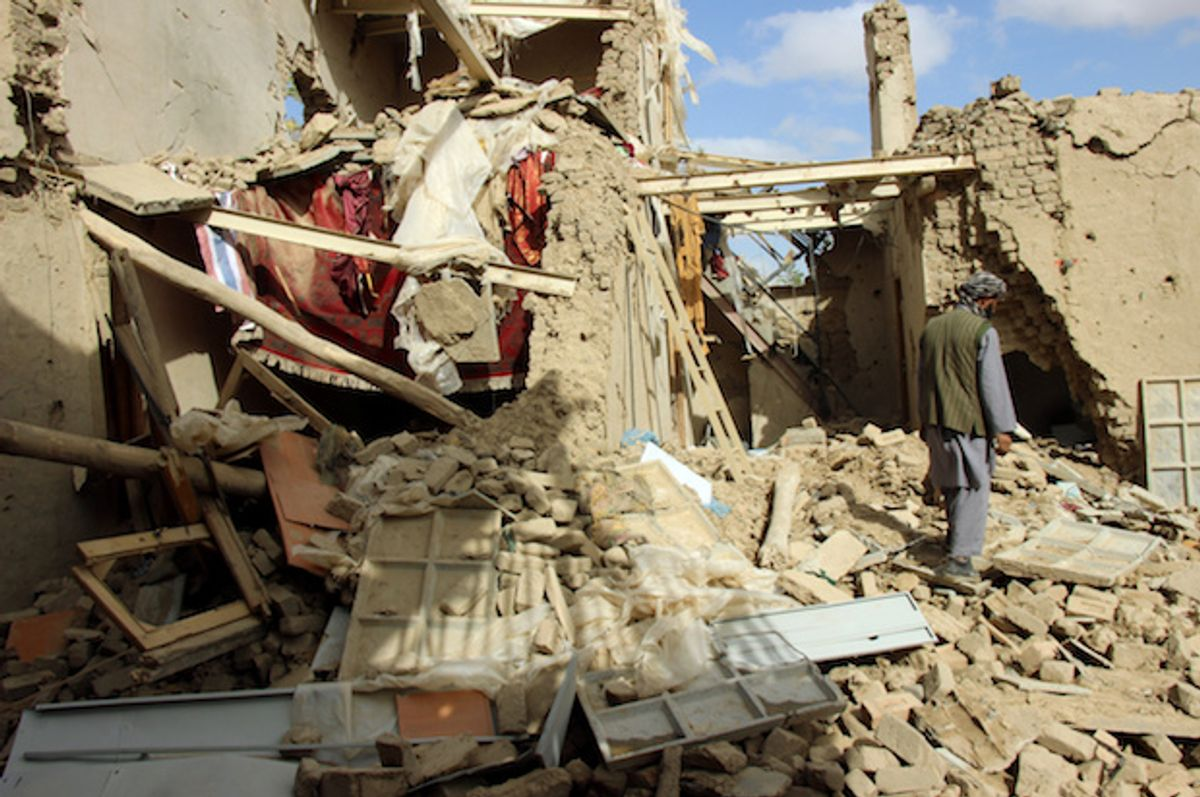 An Afghan man inspects a house destroyed during Thursday's clashes between Afghan security forces and Taliban in Kunduz, Afghanistan, on November 4, 2016  (Reuters/Nasir Wakif)