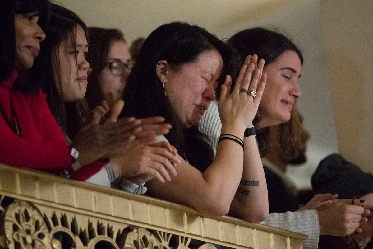 Audience members listen as Democratic presidential candidate Hillary Clinton speaks in New York, Wednesday, Nov. 9, 2016. (AP Photo/Matt Rourke)