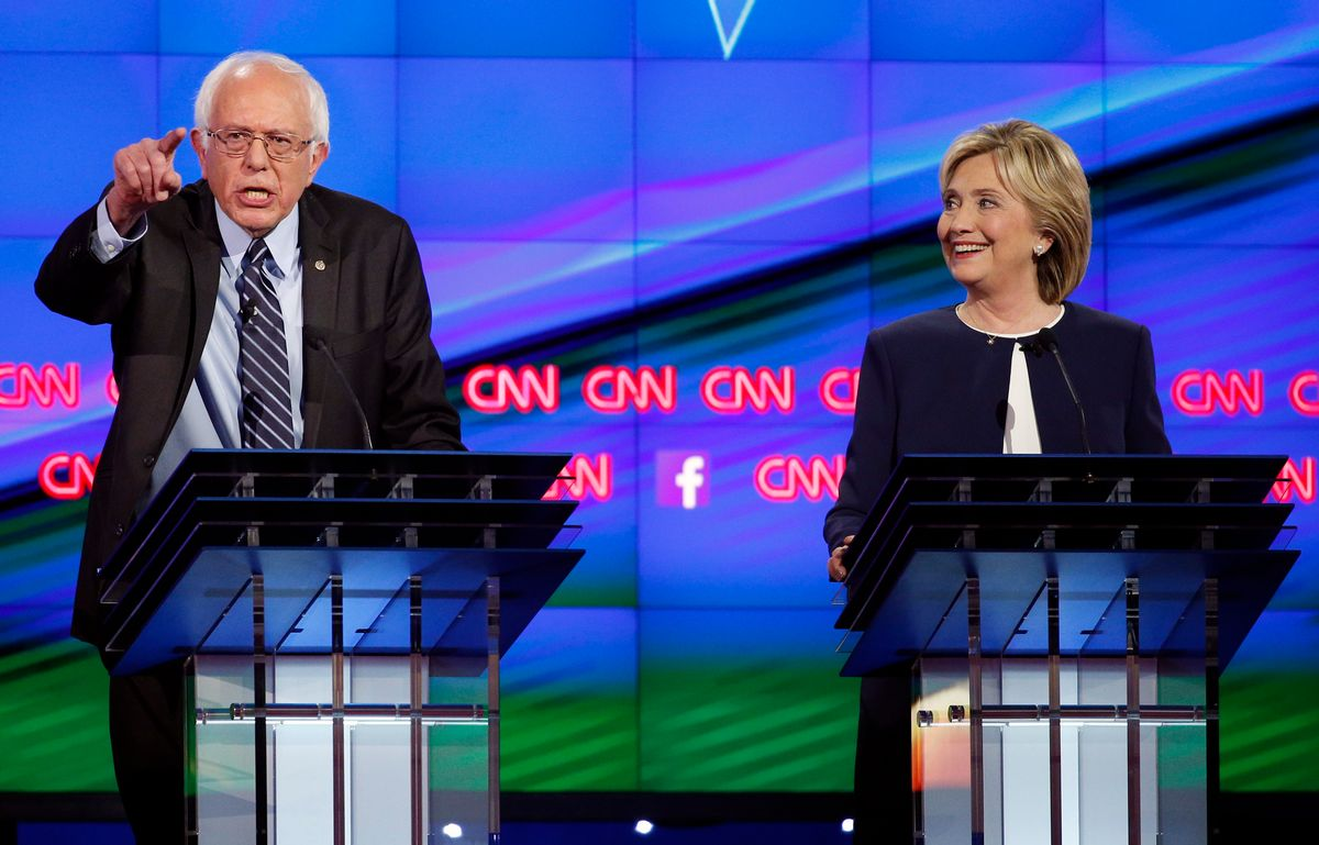 FILE - In this Tuesday, Oct. 13, 2015, file photo, Sen. Bernie Sanders, of Vermont, left, speaks as Hillary Clinton watches during a CNN Democratic presidential debate in Las Vegas. (AP Photo/John Locher, File) (AP)