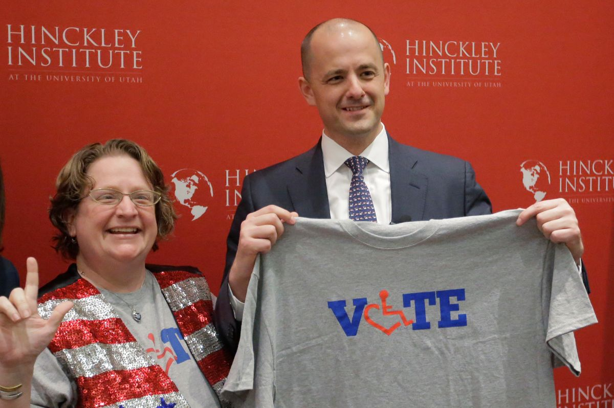 Supporter Alison Greathouse, left, poses with independent presidential candidate Evan McMullin during a University of Utah candidate forum, Wednesday, Nov. 2, 2016, in Salt Lake City. McMullin answered questions at the forum, as he attempts to fend off a new wave of critiques from Republican Donald Trump's supporters who are trying to prevent McMullin from winning what has become a toss-up state.(AP Photo/Rick Bowmer) (AP)