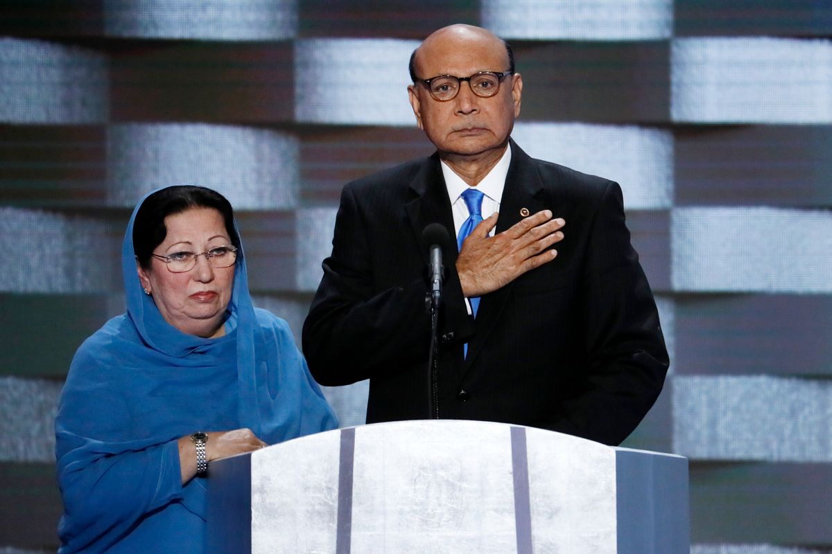FILE - In this July 28, 2016, file photo, Khizr Khan, father of fallen Army Capt. Humayun Khan and his wife Ghazala speak during the final day of the Democratic National Convention in Philadelphia. Many Muslim Americans cringe at the way they have been portrayed by candidates during the presidential campaign, either as potential terrorists or as eyes and ears who can help counterterrorism efforts. Those descriptions have been offered by Donald Trump and Hillary Clinton, respectively. And they trouble Muslims who complain they are being pigeonholed and their concerns on other issues ignored. (AP Photo/J. Scott Applewhite, File) (AP)