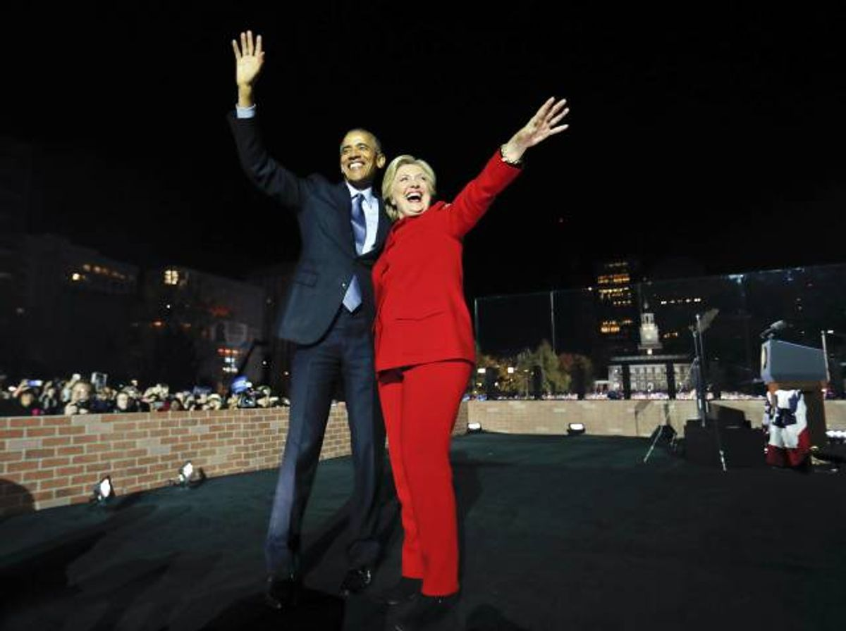 President Barack Obama waves on stage with Democratic presidential candidate Hillary Clinton during a rally at Independence Hall in Philadelphia. (AP)