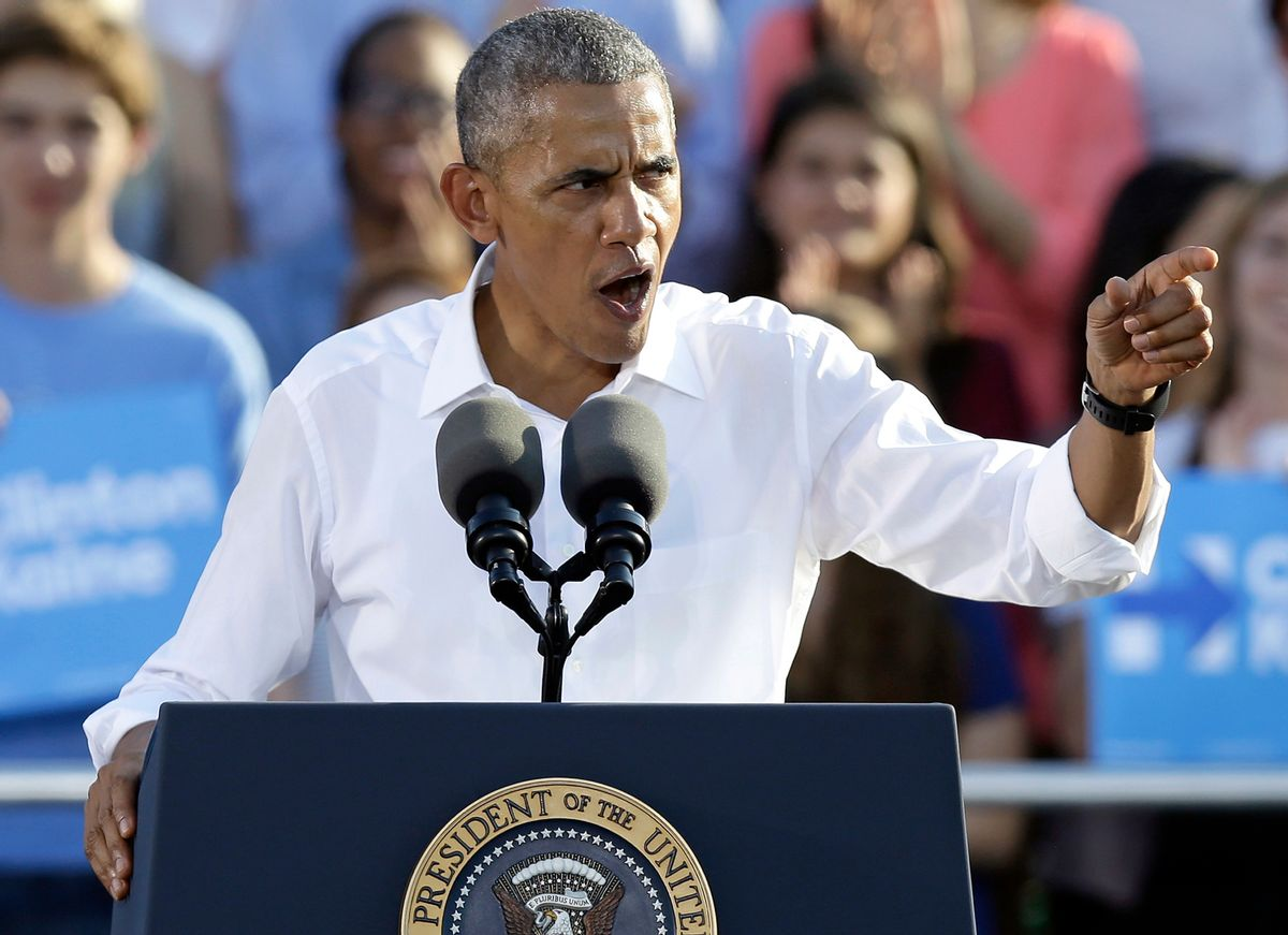 President Barack Obama speaks to supporters while campaigning for Democratic presidential candidate Hillary Clinton in Chapel Hill, N.C., Wednesday, Nov. 2, 2016. (AP Photo/Gerry Broome) (AP)