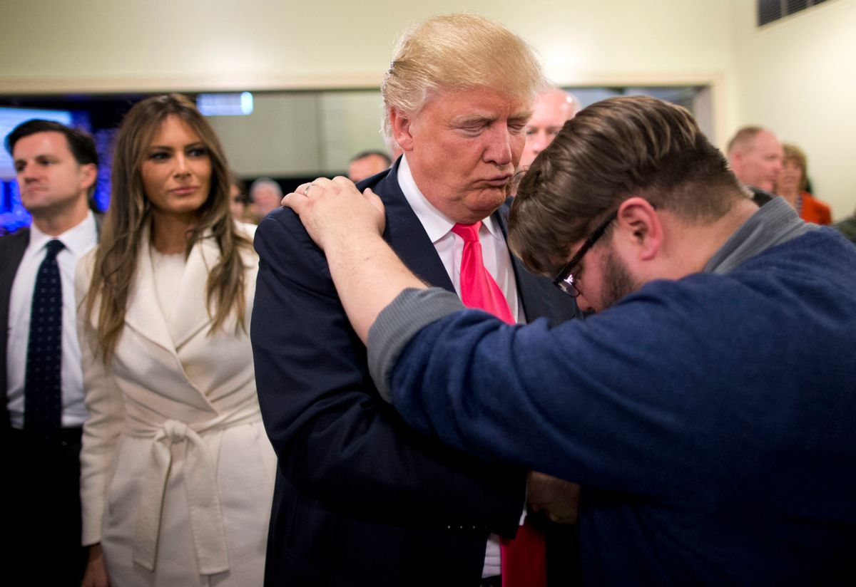 FILE - In this Jan. 31, 2016, file photo, Pastor Joshua Nink, right, prays for Republican presidential candidate Donald Trump, as his wife, Melania, left, watches after a Sunday service at First Christian Church, in Council Bluffs, Iowa.  (AP)