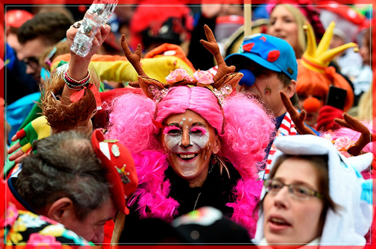 Revellers celebrate the start of the Carnival season in Cologne, on November 11, 2016. / AFP / PATRIK STOLLARZ        (Photo credit should read PATRIK STOLLARZ/AFP/Getty Images) (Afp/getty Images)
