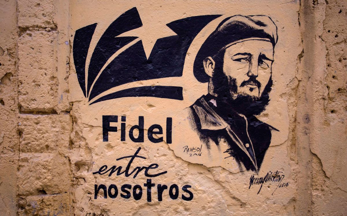 """A stencil graffiti featuring Fidel Castro's image says in Spanish """"Fidel among us,"""" in an alleyway in Havana, Cuba, Sunday, Nov. 27, 2016.  (AP)"""