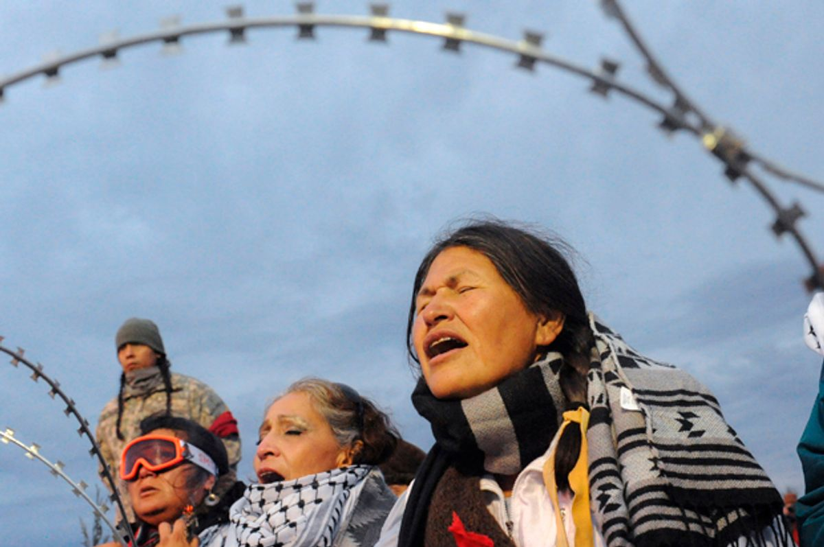 A protest against plans to pass the Dakota Access pipeline near the Standing Rock Indian Reservation, near Cannon Ball, North Dakota, November 27, 2016.   (Reuters/Stephanie Keith)