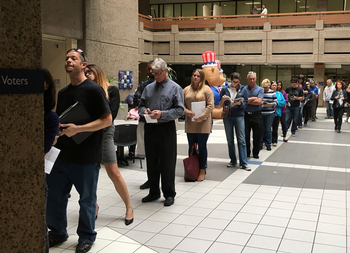 The line of voters waiting to cast an early ballot at the Santa Clara County Registrar of Voters' office winds into the building's atrium Monday, Nov. 7, 2016, in San Jose, Calif.  California elections officials are bracing for robust turnout, confused first-time voters and the prospect of long lines in a presidential election that has registered a record 19.4 million voters in the state. (Ramman Kenoun/Santa Clara Country Registrar of Voters via AP) (AP)
