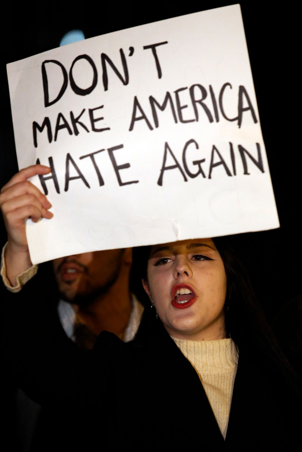 A protester holds a sign during a protest against the election of President-elect Donald Trump in Chicago, Thursday, Nov. 10, 2016. Two days after Trump's election as president, the divisions he exposed only showed signs of widening as many thousands of protesters flooded streets across the country to condemn him. (AP Photo/Nam Y. Huh) (AP)