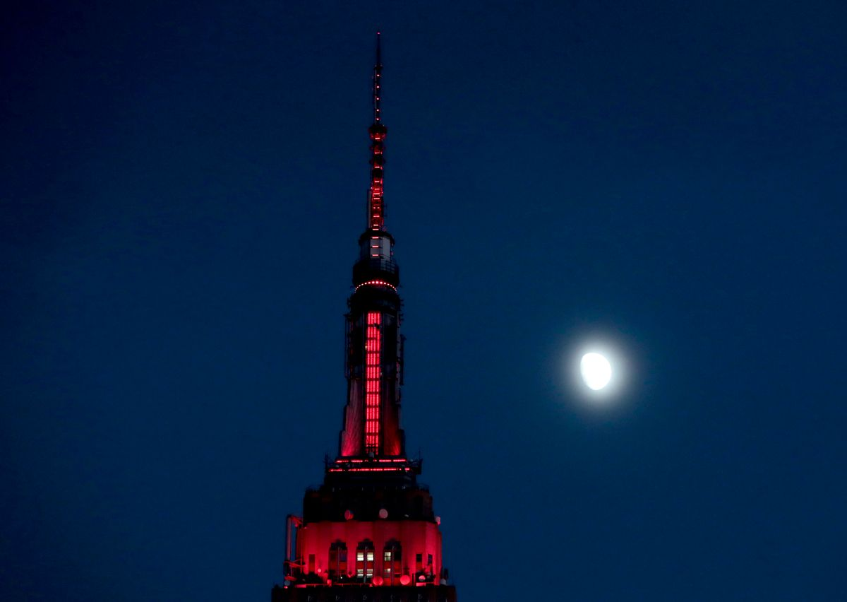 FILE - In this Thursday, Nov. 10, 2016, file photo, the moon is seen in its waxing gibbous stage as it rises near the Empire State Building, in New York. On Tuesday, Nov. 15, 2016, the Federal Reserve Bank of New York issues its Empire State manufacturing index for November. (AP Photo/Julio Cortez, File) (AP)