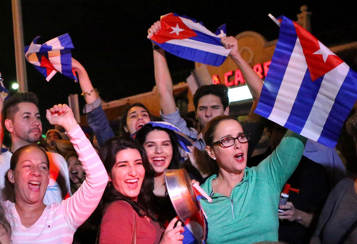 FILE- In this Nov. 25, 2016, file photo, the Cuban community in Miami celebrates the announcement that Fidel Castro died in front La Carreta Restaurant early in Miami. For the hundreds of thousands of children born of Cuban exiles, some who are two and three generations removed from the island, Fidel Castro's death potentially opens a door to a world previously off-limits. (David Santiago/El Nuevo Herald via AP, File) (AP)