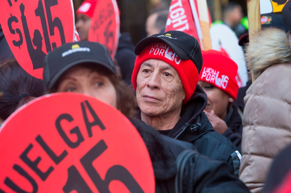 Demonstrators demanding an increase in the minimum wage to $15-dollars-per-hour prepare to march in the streets on April 14, 2016 in Chicago, Illinois   (Getty/Scott Olson)