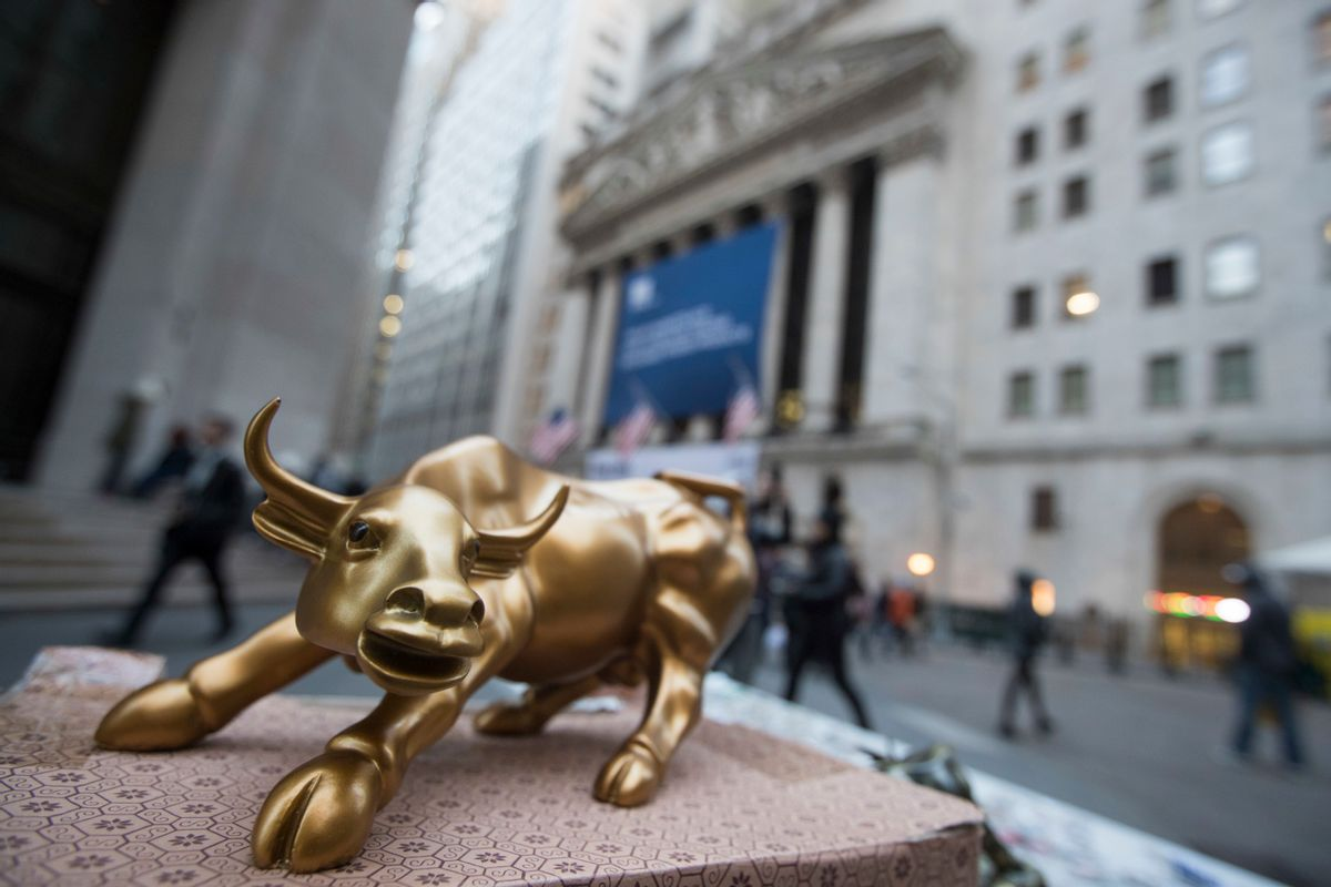 """In this Tuesday, Oct. 25, 2016, photo, a miniature reproduction of Arturo Di Modica's """"Charging Bull"""" sculpture sits on display at a street vendor's table outside the New York Stock Exchange, in lower Manhattan.  Global stock markets were mixed on Wednesday, Nov. 16, 2016,  as investors awaited more policy details from U.S. President-elect Donald Trump. Oil prices retreated, snapping an overnight rally. (AP Photo/Mary Altaffer) (AP)"""