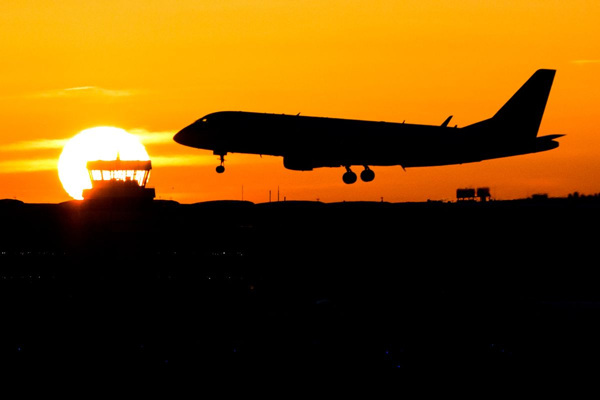 A plane lands during sunrise at the airport in Duesseldorf, Germany, Friday, Nov. 25,  2016.  Lufthansa pilots will continue their strike at least until Saturday. (Marcel Kusch/dpa via AP) (AP)