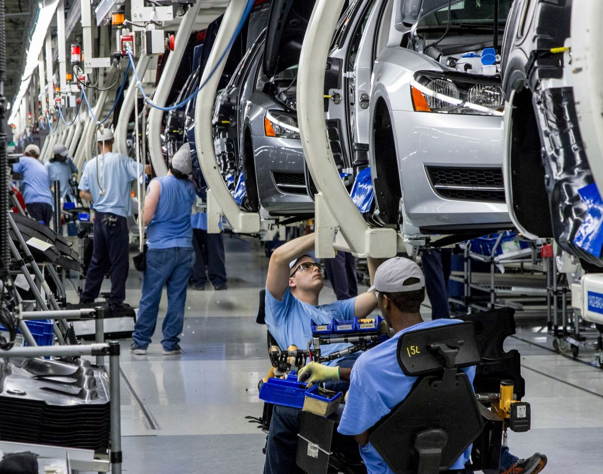 FILE - In this June 12, 2013, file photo, workers assemble Volkswagen Passat sedans at the German automaker's plant in Chattanooga, Tenn.  (AP Photo/Erik Schelzig, file) (AP)