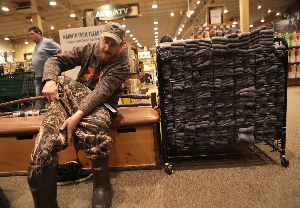 Matt Little, of St. Charles, Mo., tries on duck waders at Cabella's in Hazelwood, Mo., on Black Friday, Nov. 25, 2016. (Christian Gooden/St. Louis Post-Dispatch via AP) (AP)