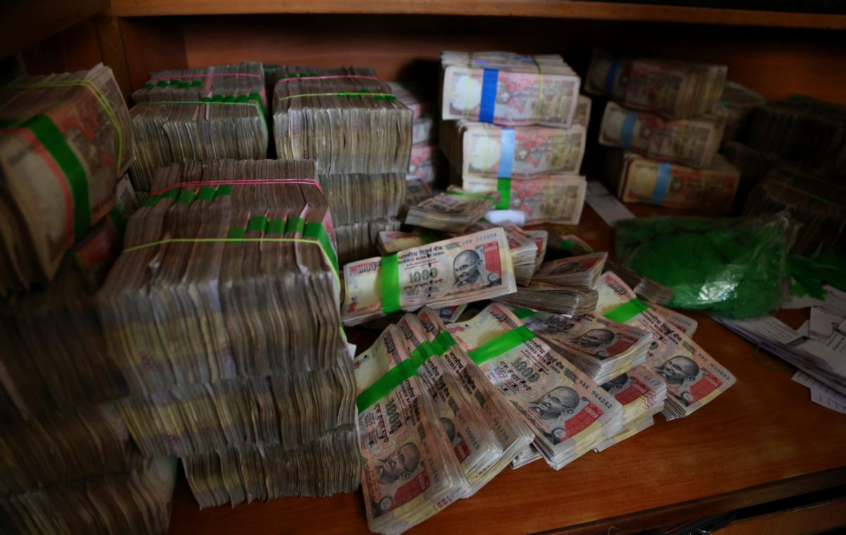 FILE - In this Nov. 10, 2016 file photo, discontinued Indian currency notes of 1,000 denomination are seen after they were deposited by people at a bank in Bangalore, India. Indian prime minister Narendra Modi, in his Nov. 8 televised address, announced the demonetization of India's 500 and 1,000-rupee notes, which made up 86 percent of the country's currency. There are doubts about whether the demonetization drive will truly make an impact on corruption and tax evasion. India's underground economy is so big it accounts for up to a quarter of the country's gross domestic product. And many of those possessing piles of black money have come up with ways to save much of it without drawing government attention. (AP)