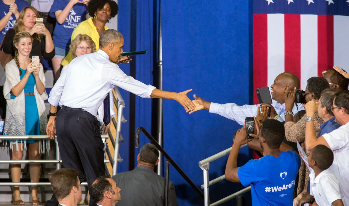 President Barack Obama shakes hand at a campaign rally for Democratic presidential candidate Hillary Clinton at the University of North Florida Arena in Jacksonville, Fla., Thursday, Nov. 3, 2016. (AP)