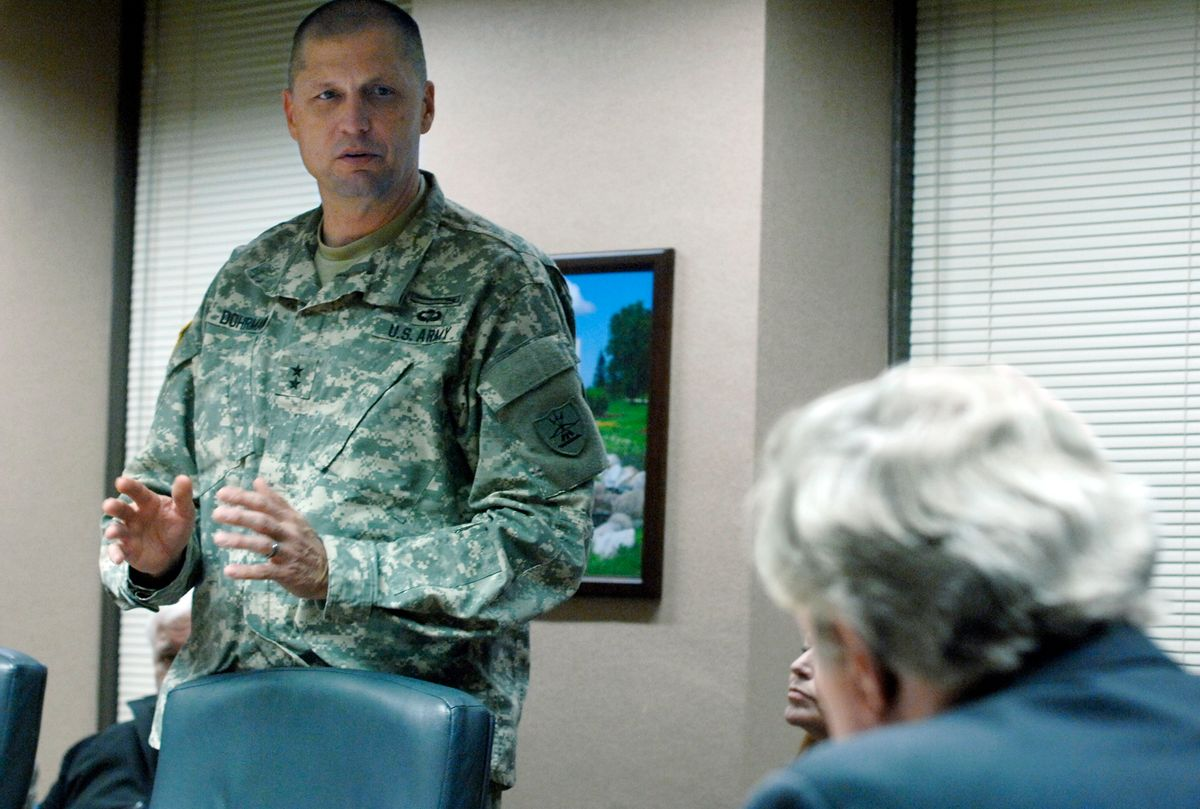 """Maj. Gen. Alan Dohrmann, the leader of the state's National Guard, speaks at the state Capitol in Bismarck, N.D., to Gov. Jack Dalrymple, right, and other members of the state Emergency Commission while requesting an additional $4 million for the North Dakota Department of Emergency Services related to law enforcement costs associated with the Dakota Access Pipeline protests in Morton County. The state agreed Tuesday to borrow an additional $4 million to cover the escalating law enforcement costs, bringing the total line of credit to $10 million. Dalrymple says officials have asked for contributions from the federal government, the pipeline company, an American Indian tribe, """"and any entity we can think of.""""  (Mike McCleary/The Bismarck Tribune via AP) (AP)"""