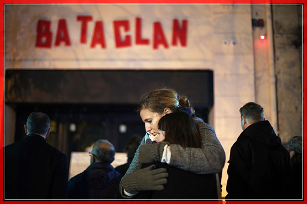 Women hug,  in front of the Bataclan concert hall in Paris, Sunday, Nov. 13, 2016.  France marked the anniversary of Islamic extremists' coordinated attacks on Paris with a somber silence on Sunday that was broken only by voices reciting the names of the 130 slain, and the son of the first person to die stressing the importance of integration. (AP Photo/Thibault Camus) (AP)