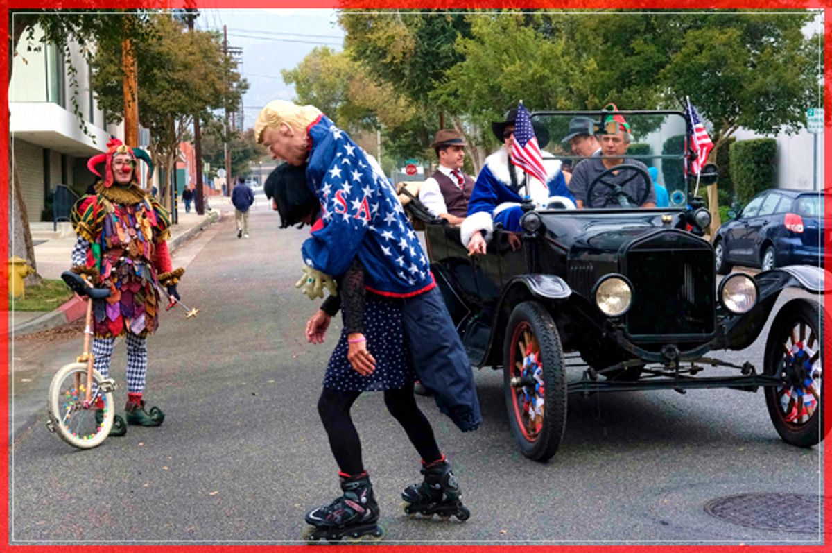 A roller skater carrying an effigy of President elect Donald Trump draped in an American flag rides down the street prior to participating in the 39th Occasional Pasadena Doo Dah Parade on Sunday, Nov. 20, 2016 in Pasadena, Calif.  (AP Photo/Richard Vogel) (AP)