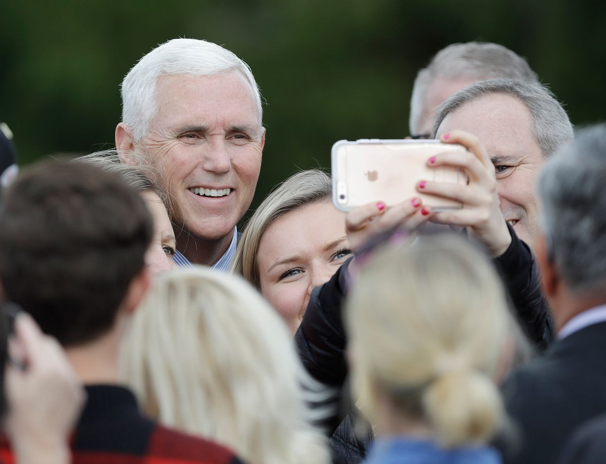 Vice President-elect Mike Pence poses for photos after speaking at a Veterans Day ceremony at Camp Atterbury in Edinburgh, Ind., Friday, Nov. 11, 2016. (AP Photo/Darron Cummings) (AP)