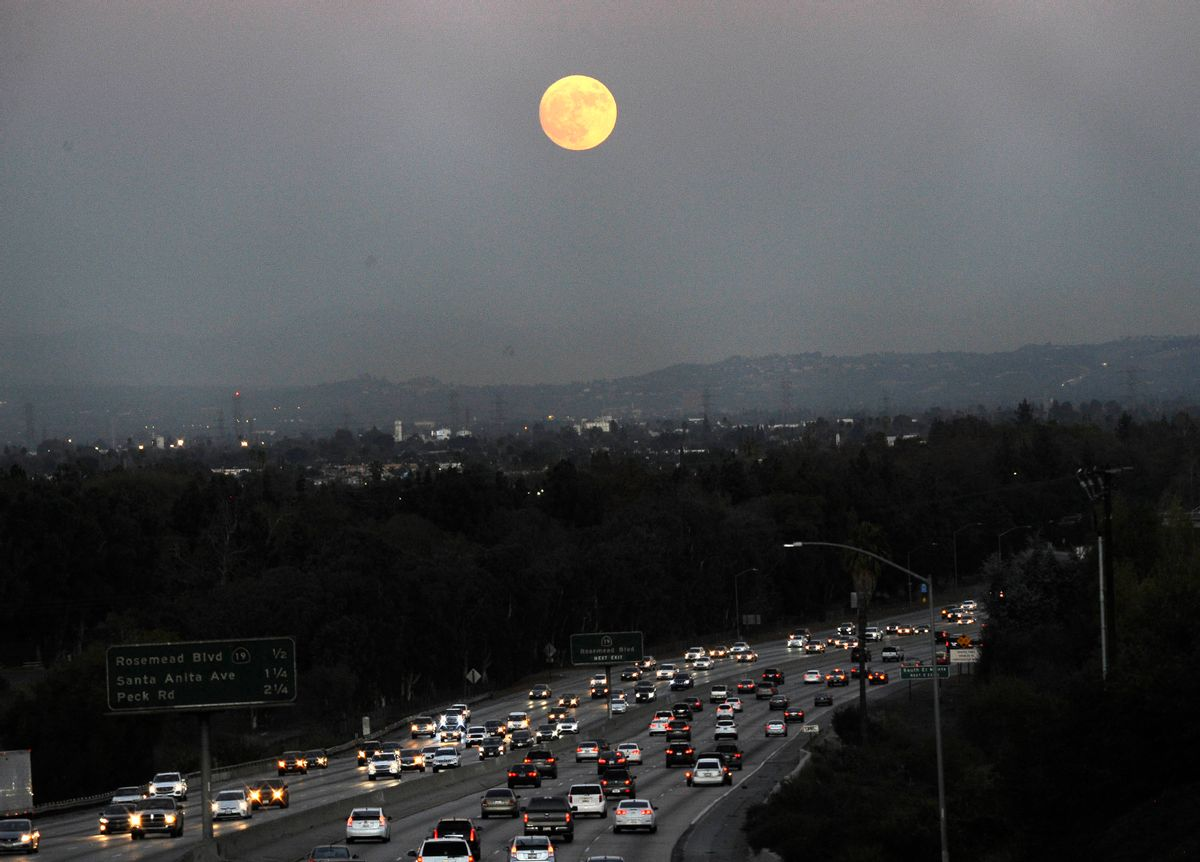 The moon rises above California 60 on Sunday, Nov. 13, 2016, in Rosemead, Calif.  (AP)