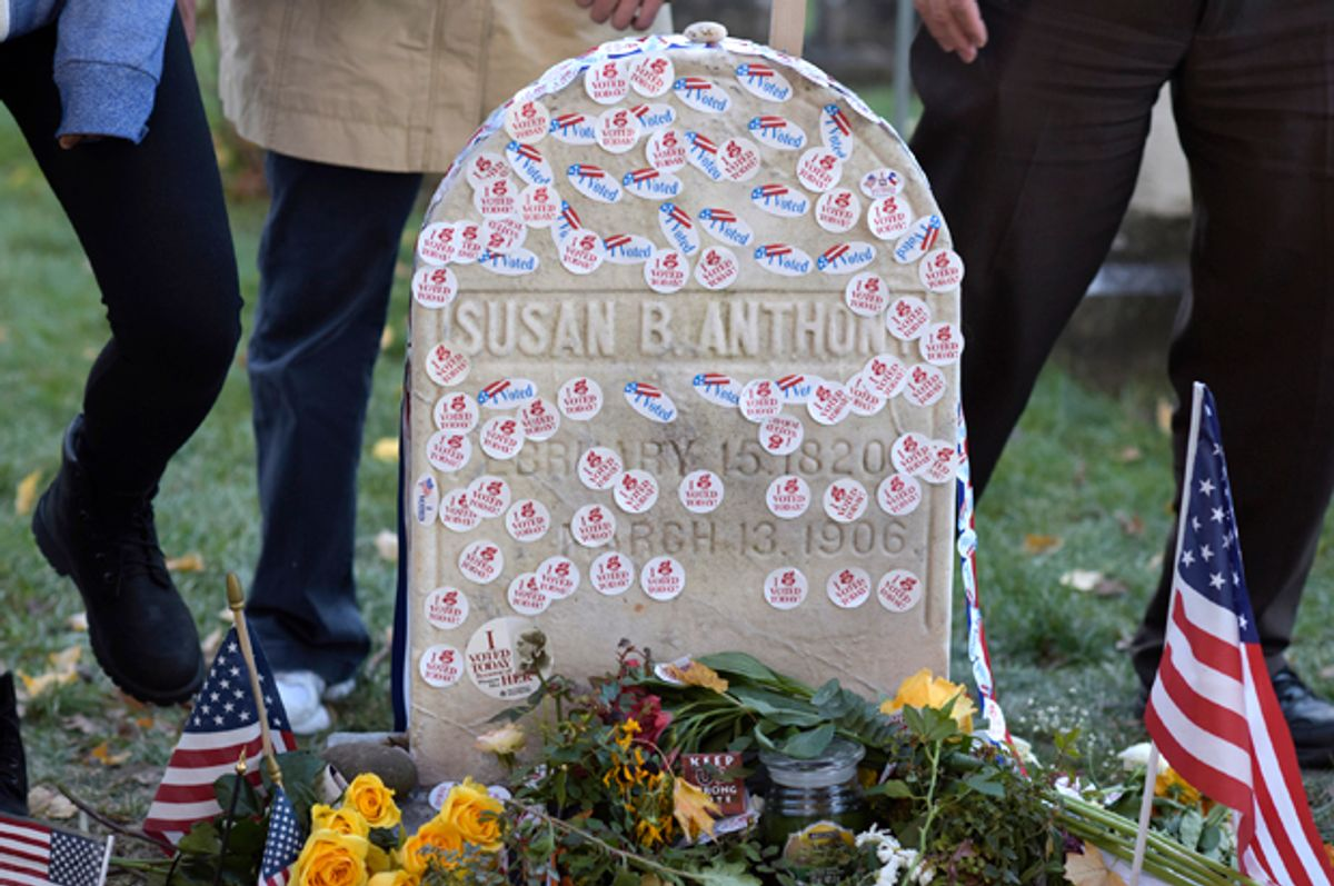 People visit the grave of Susan B. Anthony at Mount Hope Cemetery in Rochester, New York November 8, 2016.   (Reuters/Adam Fenster)