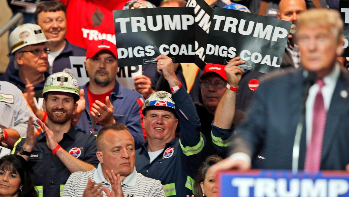 FILE- In this May 5, 2016 photo, Coal miners wave signs as Republican presidential candidate Donald Trump speaks during a rally in Charleston, W.Va. Trump's election could signal the end of many of President Barack Obama's signature environmental initiatives. Trump has said he loathes regulation and wants to use more coal and expand offshore drilling and hydraulic fracturing. (AP Photo/Steve Helber, File) (AP)