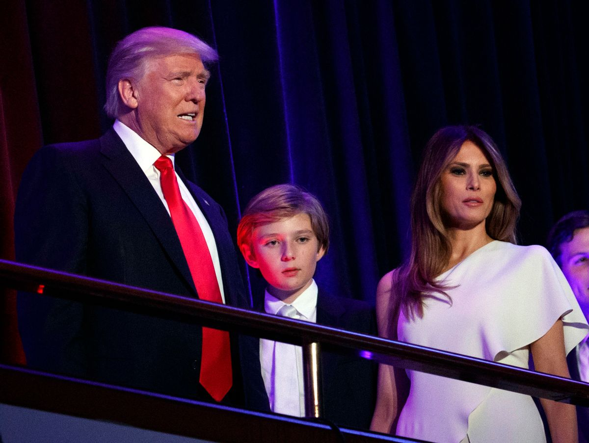 FILE - In this Nov. 9, 2016, file photo, President-elect Donald Trump, left, arrives to speak at an election night rally with his son Barron and wife Melania, in New York. Breaking with tradition, Donald Trump will move into the White House after the inauguration while wife Melania and 10-year-old son Barron plan to remain in New York City until at least the end of the school year. (AP Photo/Evan Vucci, File) (AP)