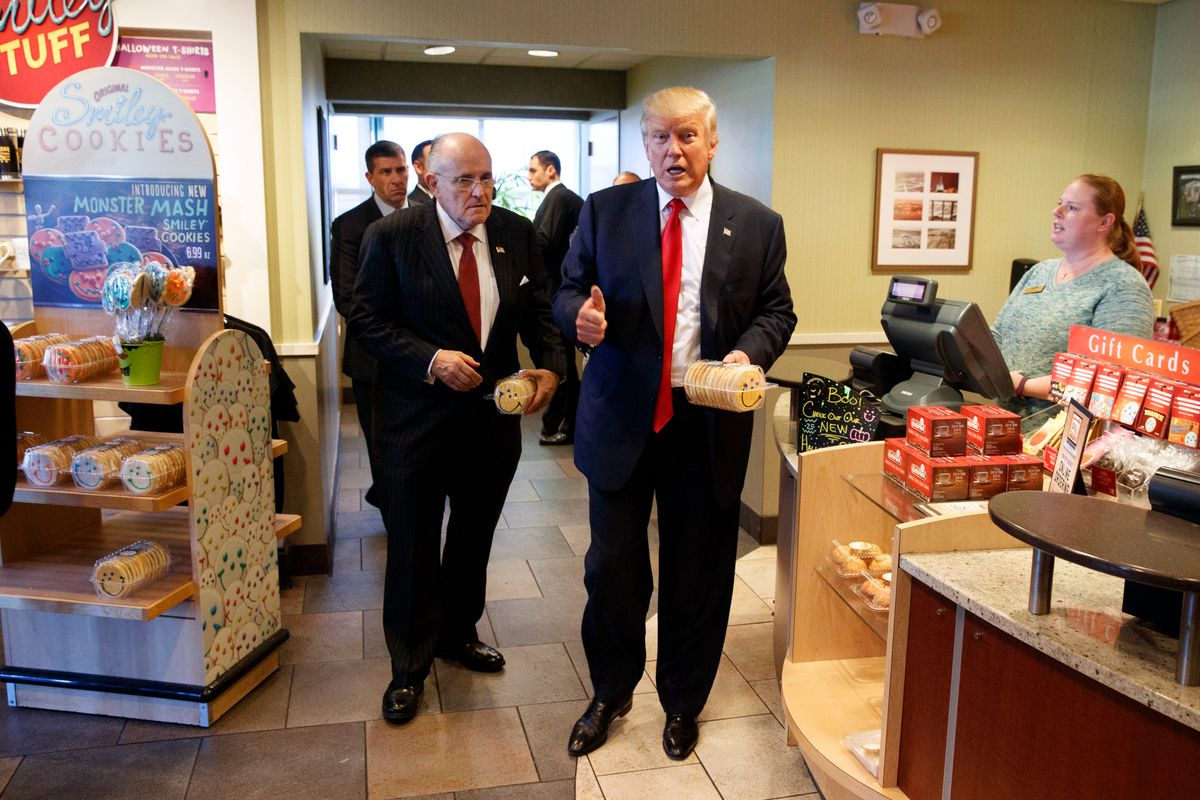 FILE - In this Oct. 10, 2016, file photo, former New York mayor Rudy Giuliani, left, stands with then-Republican presidential candidate Donald Trump as he buys cookies during a visit to Eat'n Park restaurant in Moon Township, Pa.  (AP)