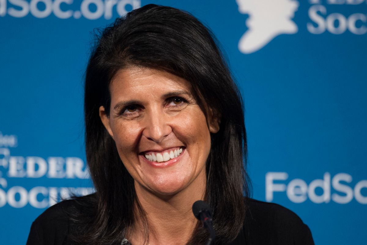 FILE - In this Friday, Nov. 18, 2016 photo, South Carolina Gov. Nikki Haley smiles while speaking at the Federalist Society's National Lawyers Convention in Washington. President-elect Donald Trump has chosen Haley as U.S. ambassador to the United Nations, and he will treat the ambassadorship as a Cabinet-level position, according to two sources familiar with Trump's decision who requested anonymity to discuss the decision and its announcement. Haley, an outspoken Trump critic throughout much of the presidential race, would become his first female - and first nonwhite - Cabinet-level official if confirmed by the Senate. (AP Photo/Cliff Owen, File) (AP)